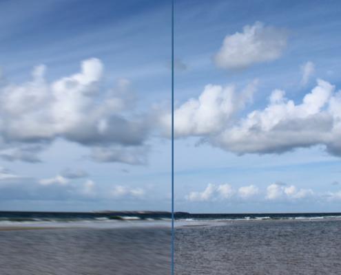 Ein Blick übers Meer, unten Wasser und Wellen, am Horizont eine andere Insel (Sylt), darüber ein blauer Himmel mit Wolken. Das Bild ist in der Mitte unterteilt, links ist es verschwommen, rechts ganz scharf. Foto: Birte Vogel